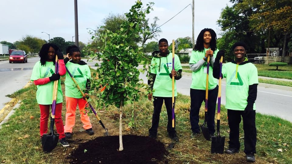 groundwork indy youth planting a tree