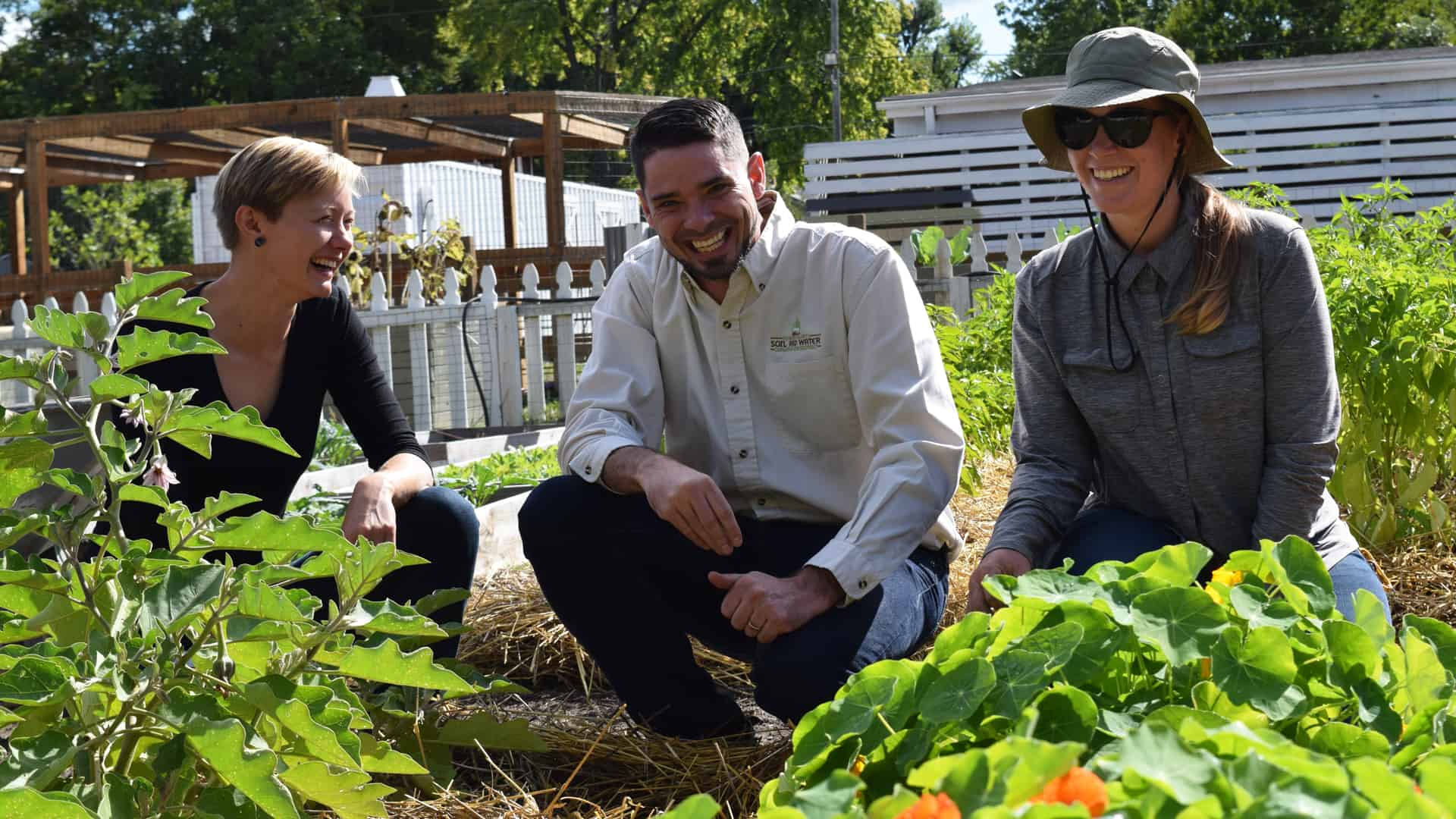Soil Health District staff laughing in garden